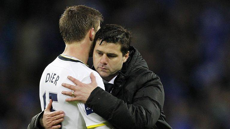 Tottenham's Mauricio Pochettino (R) consoles Eric Dier after the English League Cup Final football match against Chelsea at Wembley Stadium in 2015