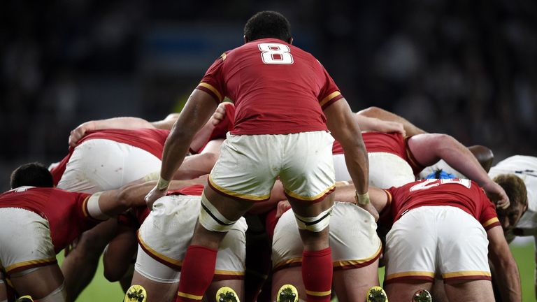 Wales No 8 Taulupe Faletau stands behind a scrum against England at Twickenham during the World Cup