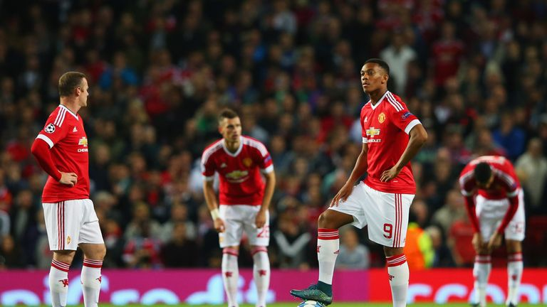 Wayne Rooney and Anthony Martial look dejected following Daniel Caligiuri's goal