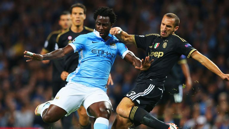 Wilfried Bony (left) is challenged by Juventus defender Giorgio Chiellini.