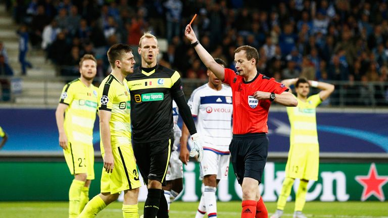 William Collum shows Thomas Foket of Gent a red card during the UEFA Champions League Group H match between KAA Gent and Olympique Lyonnais