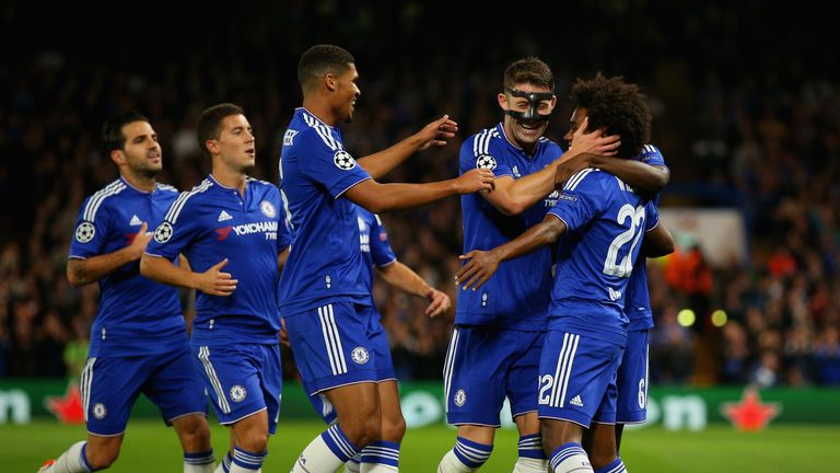 Willian of Chelsea is congratulated by Gary Cahill and Ruben Loftus-Cheek