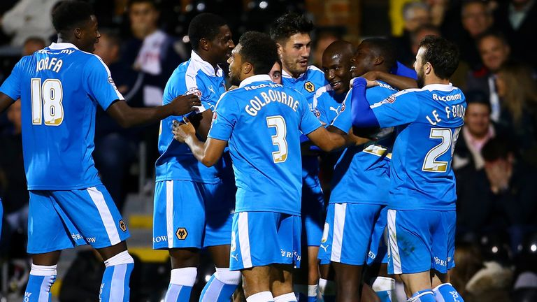 LONDON, ENGLAND - SEPTEMBER 29:  Wolves celebrate with Sheyi Ojo of Wolves after he scores to make it 2-0 during the Sky Bet Football League Championship m
