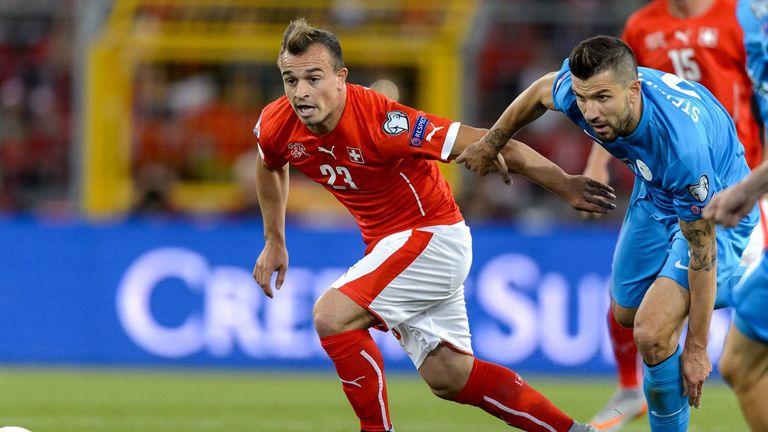 Switzerland midfielder Xherdan Shaqiri (left)