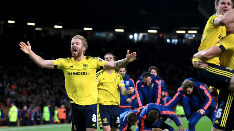 Middlesbrough's Adam Clayton celebrates winning the penalty shootout with teammates following the Capital One Cup, Fourth Round match at Old Trafford