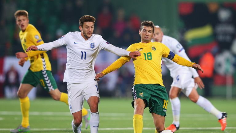 Mindaugas Panka of Lithuania holds off Adam Lallana of England during the UEFA EURO 2016 qualifying Group E match between