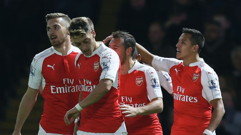 Alexis Sanchez of Arsenal (R) celebrates with team mates as he scores their first goal