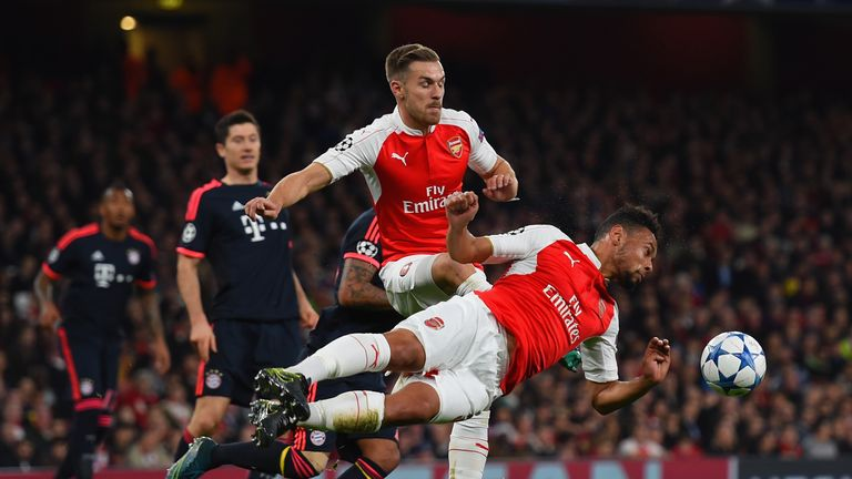 Francis Coquelin of Arsenal dives to head the ball clear ahead of team-mate Aaron Ramsey