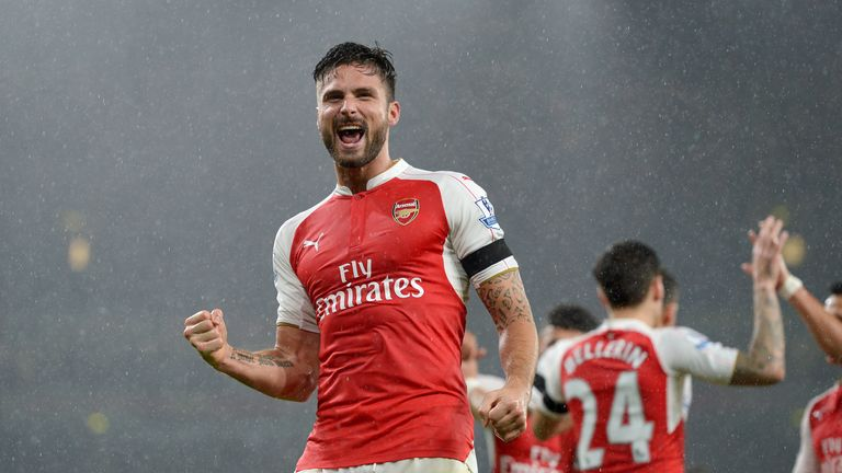 Arsenal's Olivier Giroud celebrates scoring his side's first goal during the Barclays Premier League match v Everton at the Emirates Stadium