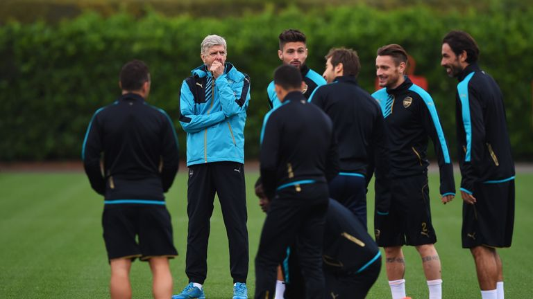 Arsene Wenger oversees training on Monday ahead of Arsenal's Champions League game against Bayern Munich
