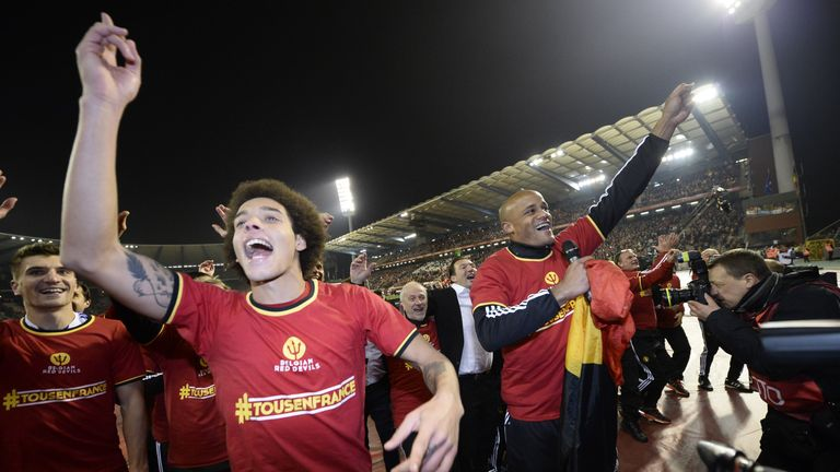 Belgium's players celebrate at the end of the Euro 2016 qualifying football match between Belgium and Israel,