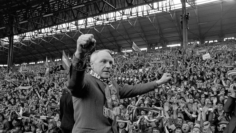 Liverpool's legendary Bill Shankly.  Turning towards the Kop end of Anfield, Shankly gets an ovation from the fans who idolised him.
