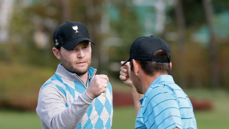 branden grace gets international team to within a point of