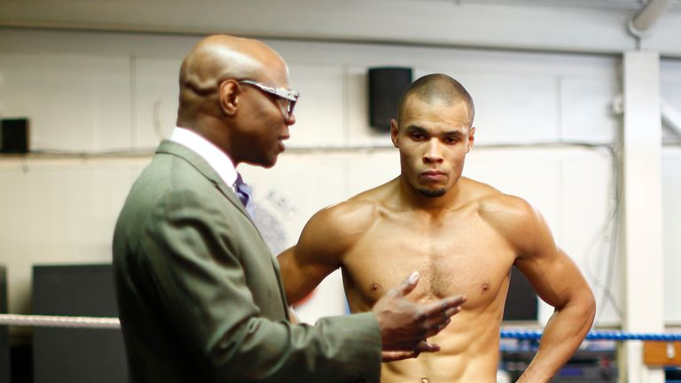 LONDON, ENGLAND - FEBRUARY 24:  Chris Eubank Jnr listens to father Chris Eubank after a media work out at the Peacock Gym on February 24, 2015 in London, E