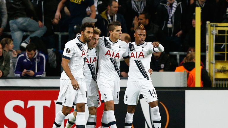 Christian Eriksen (2nd L) of Spurs is congratulated by teammates after scoring the opening goal