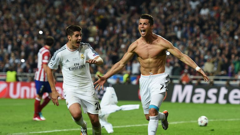 LISBON, PORTUGAL - MAY 24:  Cristiano Ronaldo of Real Madrid celebrates with Alvaro Morata of Real Madrid after scoring their fourth goal from the penalty