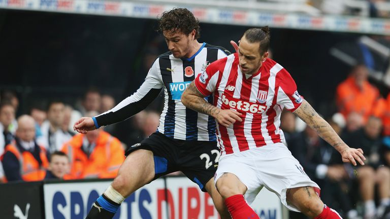 Daryl Janmaat tangles with Marko Arnautovic during Newcastle's recent 1-0 loss at Stoke