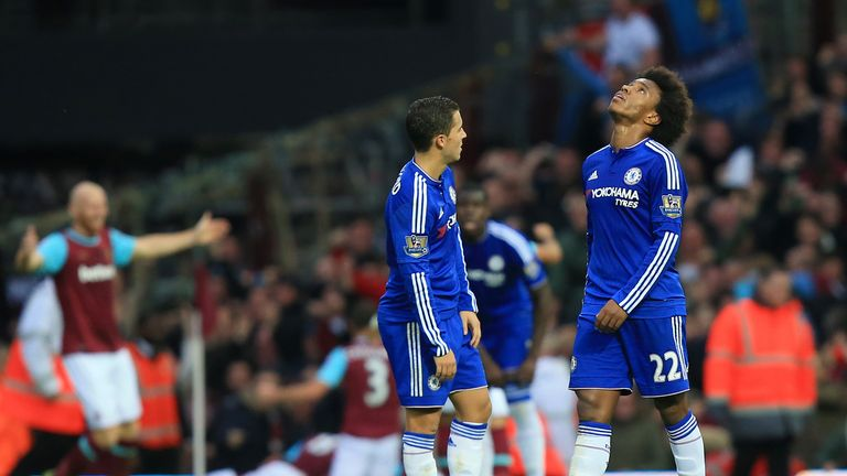 Chelsea's Willian (right) and Eden Hazard look dejected as West Ham United celebrate Andy Carroll's goal
