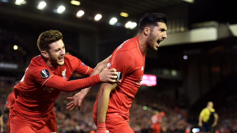 Emre Can (right) is congratulated by team-mate Adam Lallana after scoring a goal to level up at Anfield
