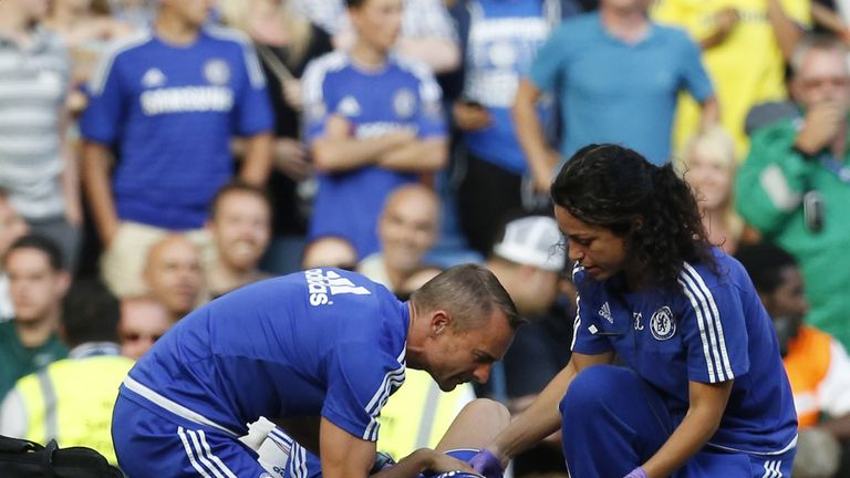 Chelsea doctor Eva Carneiro and head physio Jon Fearn treat Eden Hazard at Stamford Bridge in August