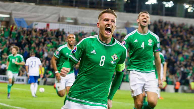 Northern Ireland's Steven Davis celebrates after scoring his side's third goal against Greece
