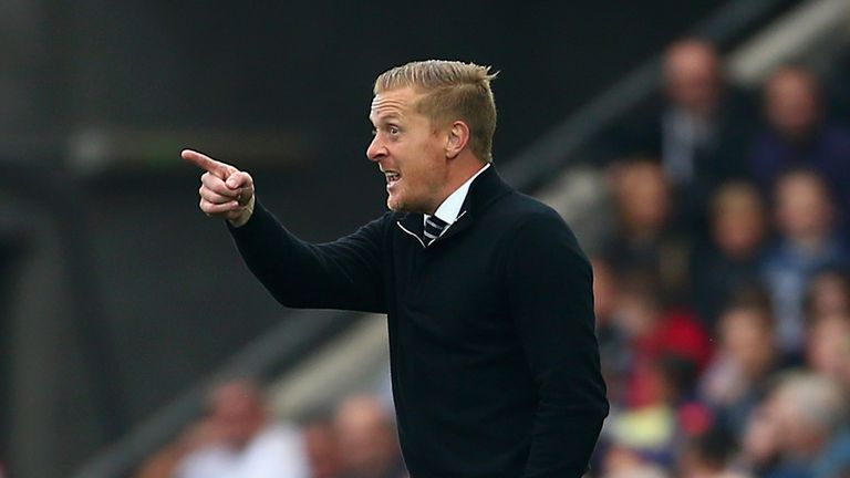 Garry Monk says it is time for the Euro 2016 qualifiers to turn their full attention to Swansea
