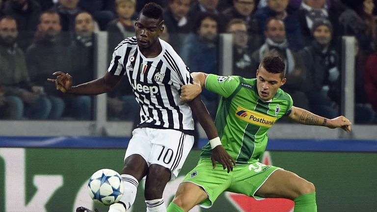 Paul Pogba vies with Monchengladbach's Swiss midfielder Granit Xhaka