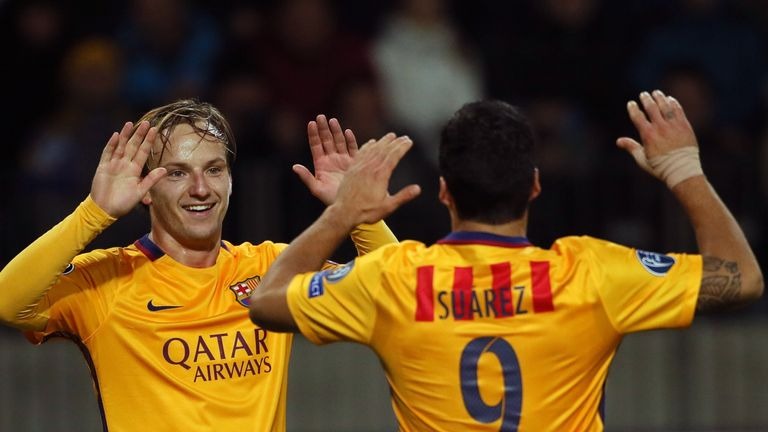 Ivan Rakitic celebrates his first Barcelona goal of the season with Luis Suarez