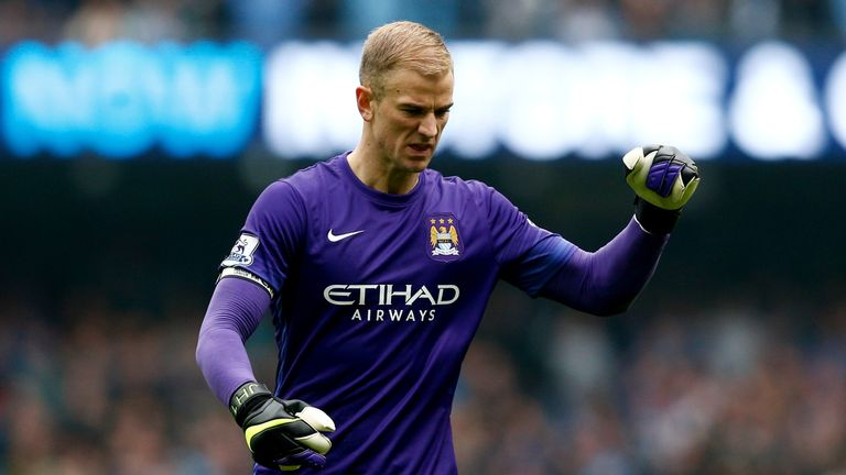Joe Hart of Manchester City celebrates his team's first goal during the Barclays Premier League match between Manchester City and Newcastle