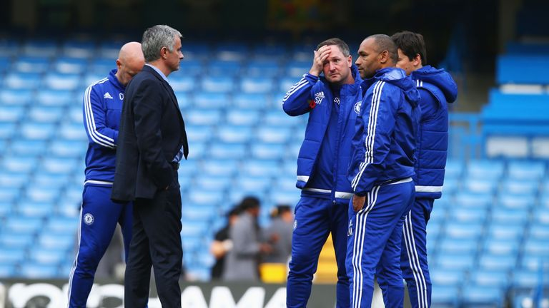 Mourinho talks to his staff following Chelsea's 3-1 defeat to Liverpool