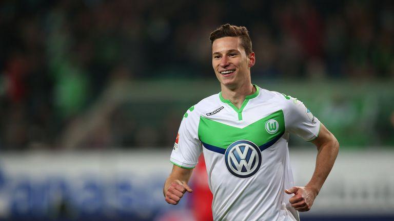 Julian Draxler of Wolfsburg celebrates after scoring his team's second goal during the Bundesliga match between VfL Wolfsburg and Bayer Leverkusen