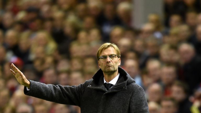 Jurgen Klopp directs his players in his first match in charge at Anfield