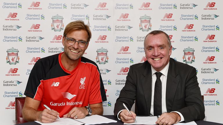 Jurgen Klopp signs his contract to manage Liverpool with chief executive Ian Ayre.
