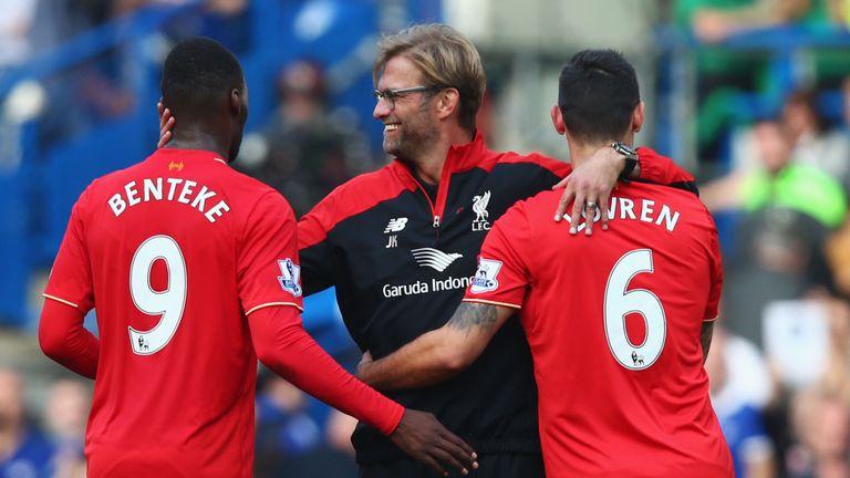 LONDON, ENGLAND - OCTOBER 31:  Jurgen Klopp (C), manager of Liverpool celebrates his team's 3-1 win with his players Christian Benteke (L) and Dejan Lovren