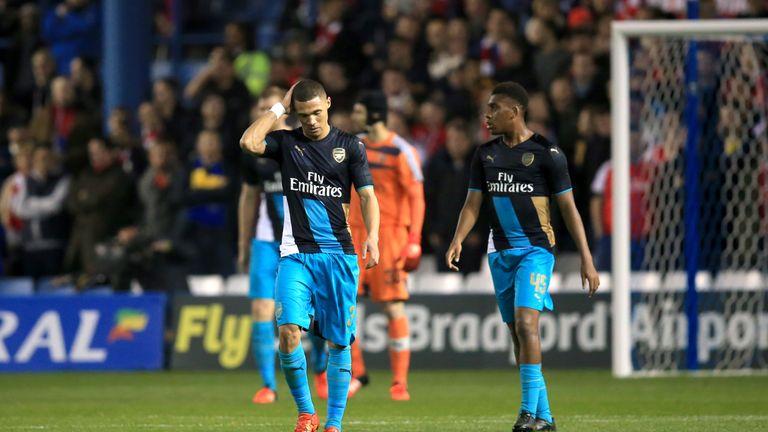 Arsenal's Kieran Gibbs walks away dejected after Sheffield Wednesday score their first goal