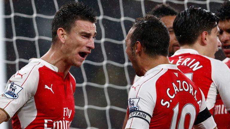 Laurent Koscielny (left) celebrates after scoring Arsenal's second goal