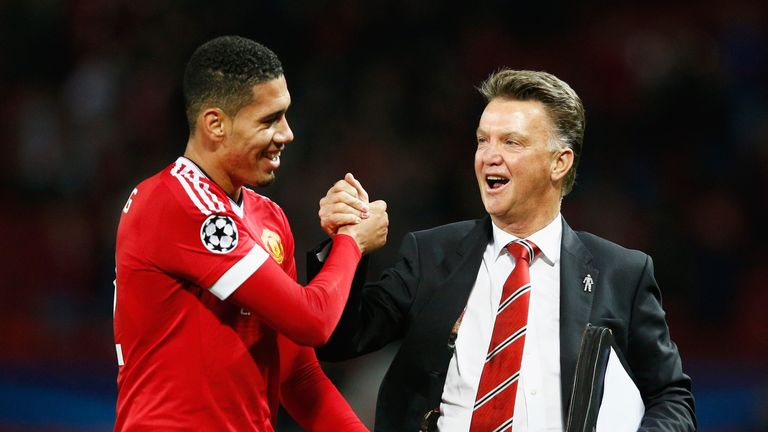 Louis van Gaal celebrates victory victory over Wolfsburg with Chris Smalling