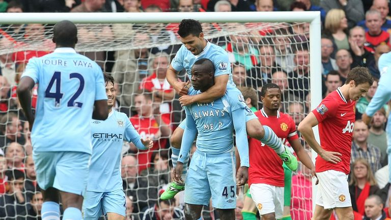 Mario Balotelli of Manchester City celebrates scoring their first goal of a 6-1 victory at Old Trafford in October 2011
