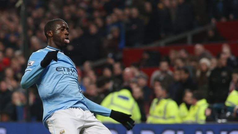 Yaya Toure of Manchester City celebrates scoring their third goal in a 3-0 victory at Old Trafford on March 25, 2014