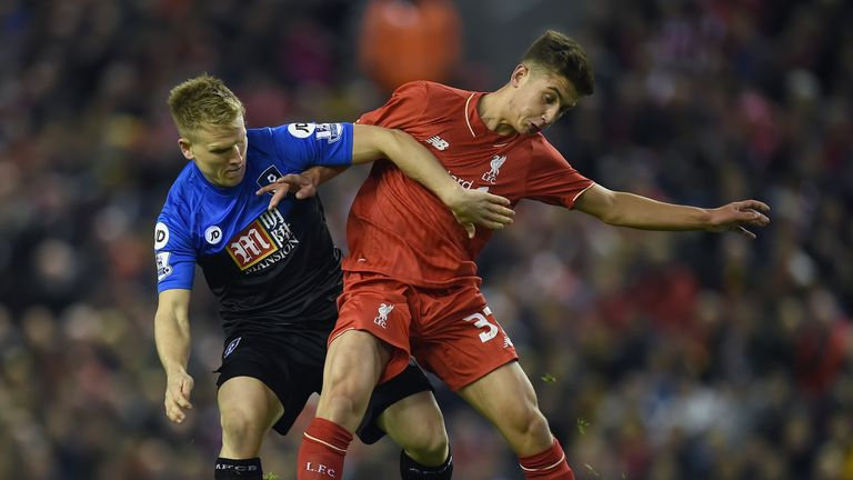 Bournemouth's Matt Ritchie vies for the ball with Liverpool's Cameron Brannagan