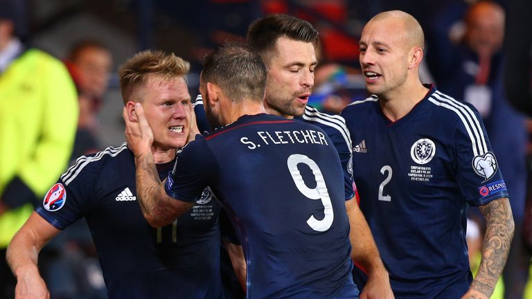 Matt Ritchie (L), of Scotland celebrates scoring late in the first half with team mates during the EURO 2016 Qualifier between Scotland and Poland