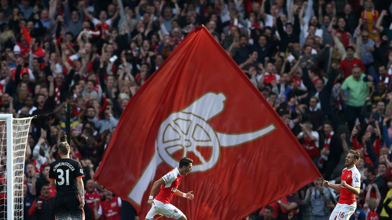Arsenal's Mesut Ozil (centre) celebrates hs goal in front of the home fans