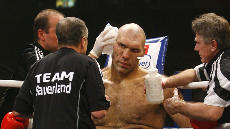 Russian WBA heavyweight champion Nikolai Valuev listens to his coaches on the ring during his WBA heavyweight boxing world champion match against  British