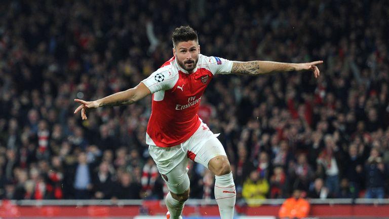 Olivier Giroud celebrates scoring a goal for Arsenal