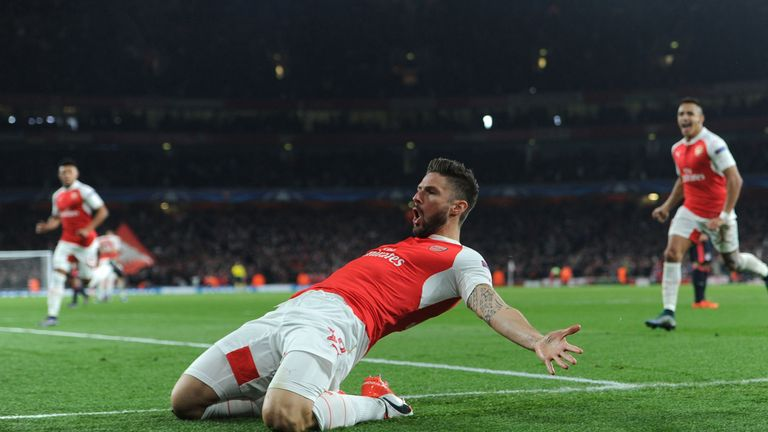 Olivier Giroud celebrates scoring a goal for Arsenal during the UEFA Champions League match between Arsenal and Bayern Munich