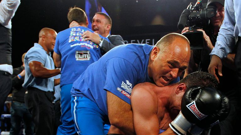 Peter Sims embraces Darren Barker after the Londoner won his world title in 2013