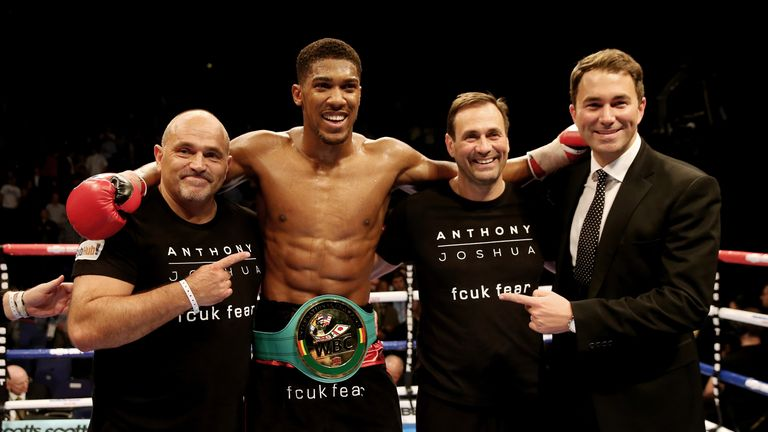 Peter Sims (L) and brother Tony (second right) are in Anthony Joshua's corner