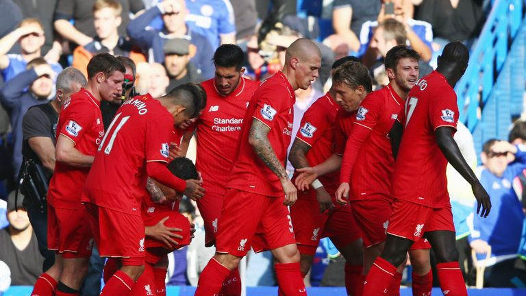 Liverpool's Philippe Coutinho (third left) celebrates his equaliser - just before half-time