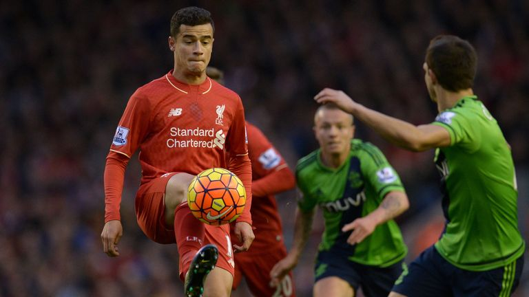 Liverpool's Philippe Coutinho controls the ball under pressure
