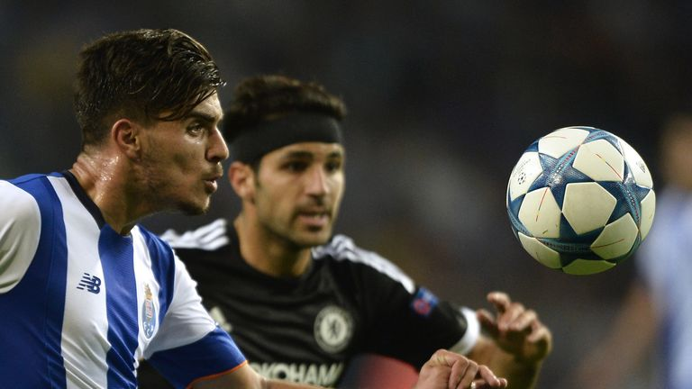 Porto's midfielder Ruben Neves (L) vies with Chelsea's Spanish midfielder Cesc Fabregas